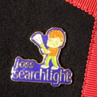 Joss Searchlight enamel badge